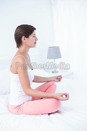 peaceful woman doing yoga in her