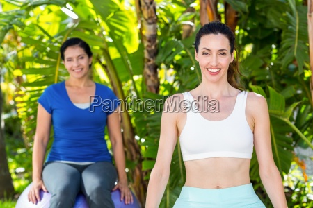 smiling woman and her trainer looking