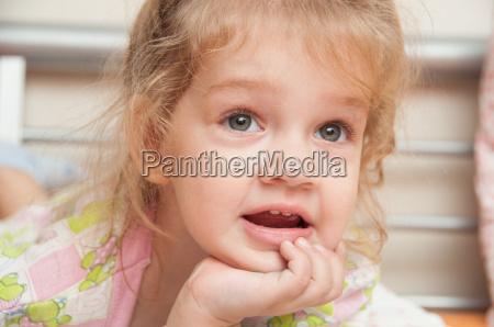 portrait of cheerful three year girl