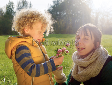 little boy in autumn clothes gives