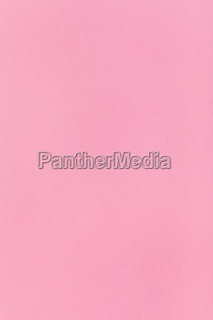 pink colored vertical sheet of paper