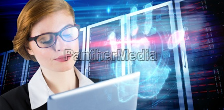 composite image of redhead businesswoman using