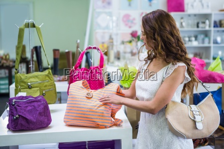 pretty woman shopping for bags