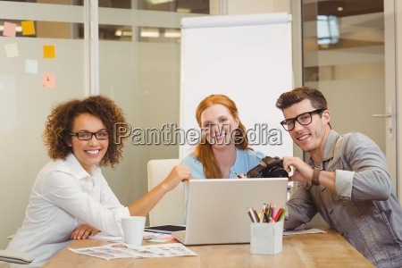 business people with camera and laptop