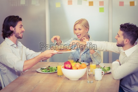 businessman serving sandwiches during lunch