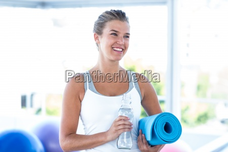 beautiful woman smiling while holding water