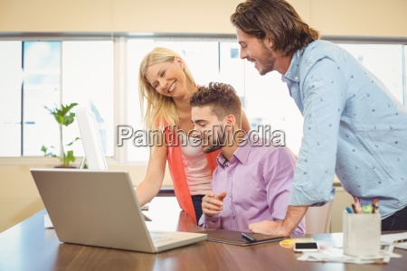 business people at desk using laptop
