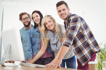 portrait of smiling business people working