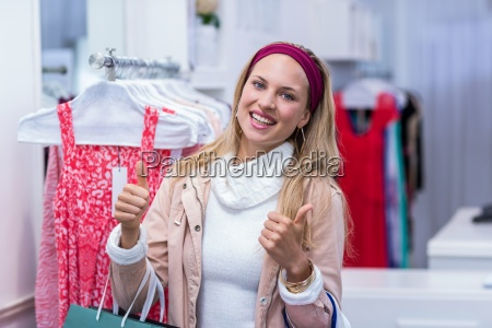 smiling woman with shopping bags looking