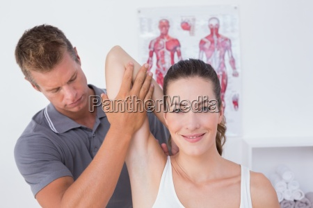 doctor examining his patient arm