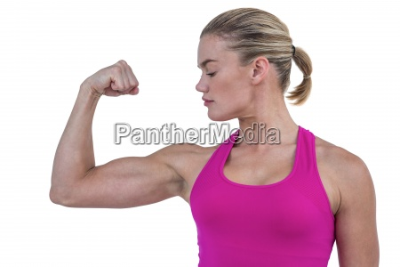 mid section of muscular woman flexing