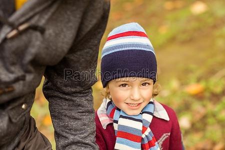 portrait of little boy walking with