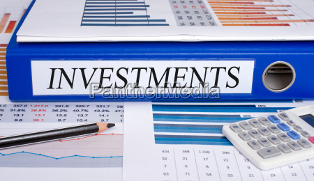investments blue binder in the office