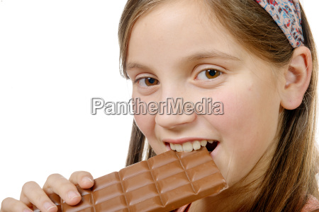 portrait of a young girl eating