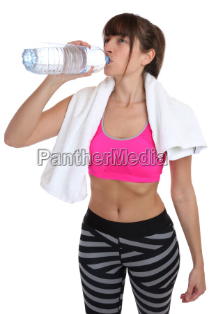 fitness young woman drinking water sports