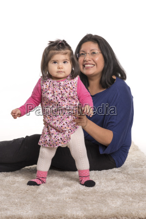 mum with child at first steps
