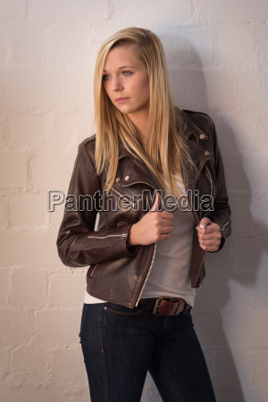 young girl in jeans and leather