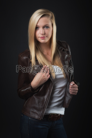 young blond girl in leather jacket
