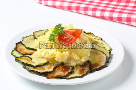 circle of roasted zucchini slices with