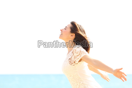 happy woman enjoying the wind and