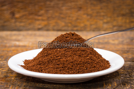 ground coffee in white plate