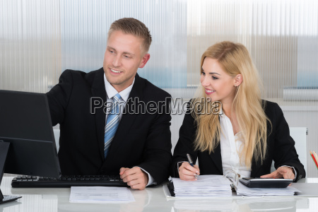 business people with paperwork discussing over
