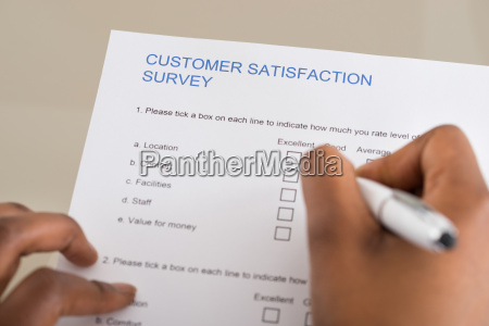 person filling customer satisfaction form
