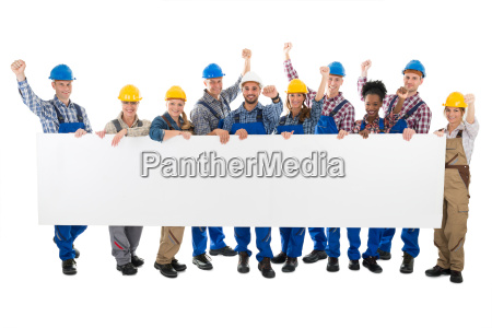 happy carpenters with arms raised holding