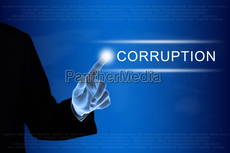 business hand clicking corruption button on