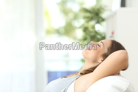 woman relaxing lying on a couch