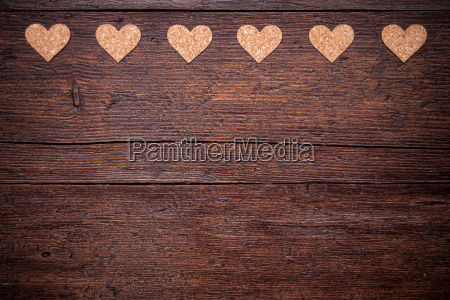 small hearts on a wooden background