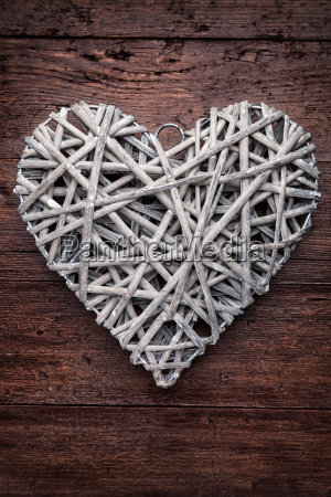 large heart on a wooden background
