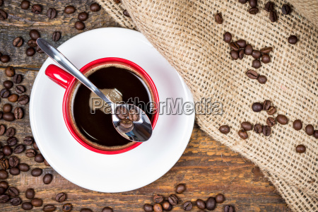 coffee beans on spoon on top