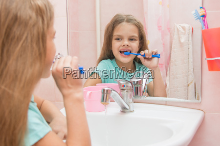 six year old girl cleans the