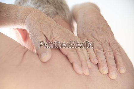 older man with hands on his
