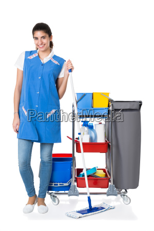 happy female janitor mopping by trolley