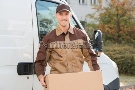 delivery man carrying cardboard box mit