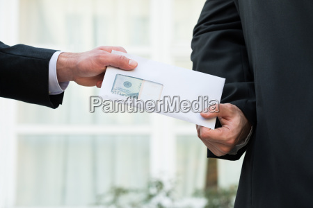 businessman receiving bribe from partner
