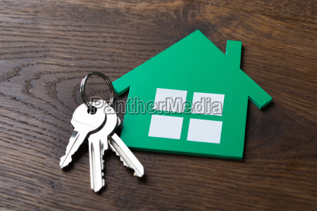green paper house and keys on