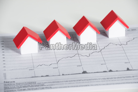 house models on financial chart at