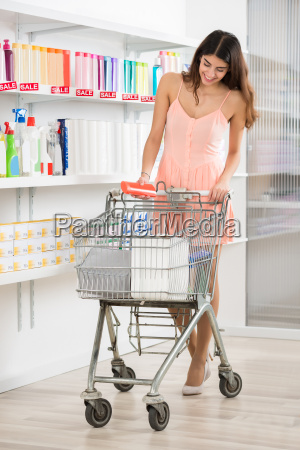 woman buying beauty product in supermarket