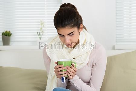 sad woman holding tee mug on