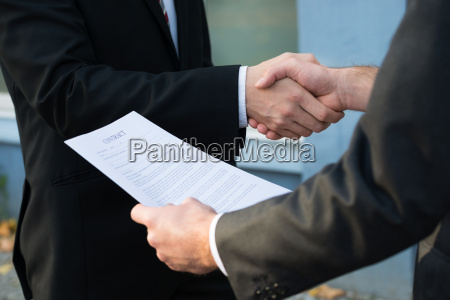businessman shaking hands with partner