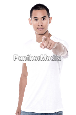 man pointing front over white background