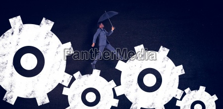 composite image of businessman walking and