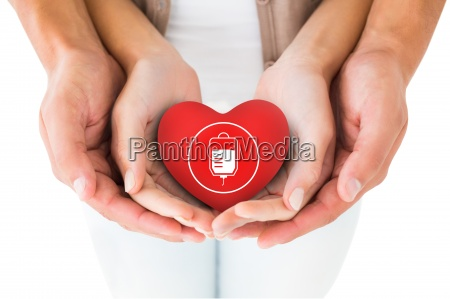composite image of couple holding miniature