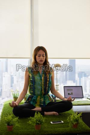 business woman doing yoga meditation on