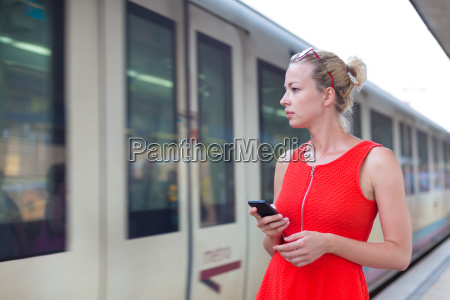 young woman on platform of railway