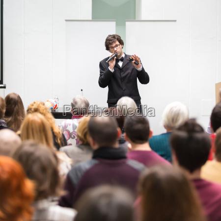 speaker talking at business conference