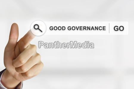 business hand clicking good governance button